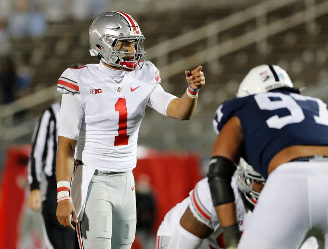 Ohio State Buckeyes quarterback Justin Fields (1) calls a play at the line of scrimmage during the third quarter of the NCAA football game at Beaver Stadium in University Park, Pa. on Sunday, Nov. 1, 2020.