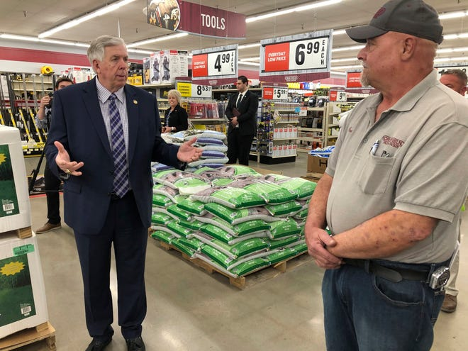 In this May 7 photo, Gov. Mike Parson, left, talks with store manager Ron Schuman, right, during a tour of the Orscheln Farm & Home store in Jefferson City. Parson was visiting the store to promote the end of a stay-at-home order he had issued because of the coronavirus pandemic. Midwest governors credit their lack of restrictions for low unemployment rates, but economists and others say other factors might be more important in the states low jobless rates.