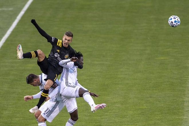Crew winger Pedro Santos goes up for a header between Philadelphia Union players on Sunday at Mapfre Stadium.