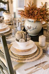 This design sidesteps traditional fall colors and plays up the crisp lines in the home with soft, neutral linens and textures.