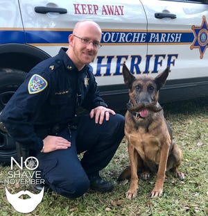 Lafourche Parish sheriff's Sgt. Lance Leblanc and his K-9 partner Baretta during last year's No Shave November campaign.