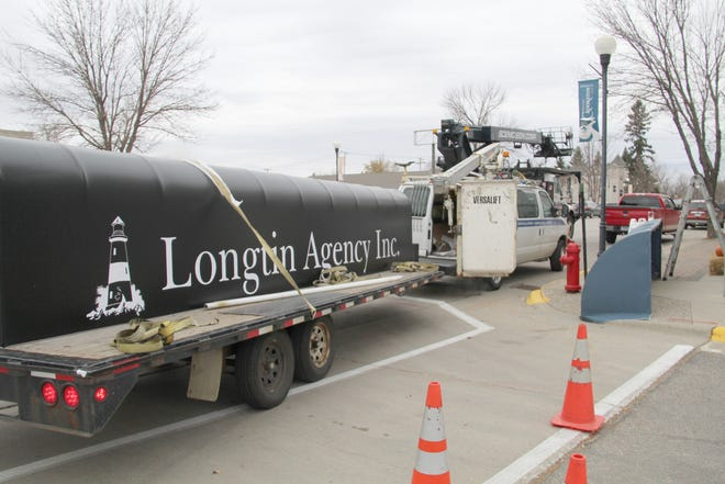 Longtin Agency replaced their awning Thursday
