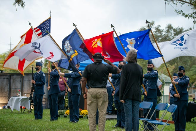 People salute the flag durin the presentation of colors at the Vet Fest of Lake County closing ceremony on Sunday. [Cindy Peterson/Correspondent]