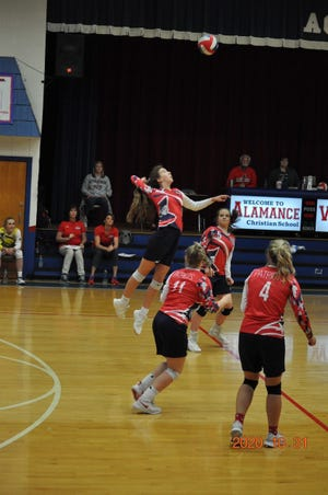 Union Grove's Katy Brauser goes for a kill in the Patriots' NCCSA 2-A state championship match at Wilson Christian on Saturday.