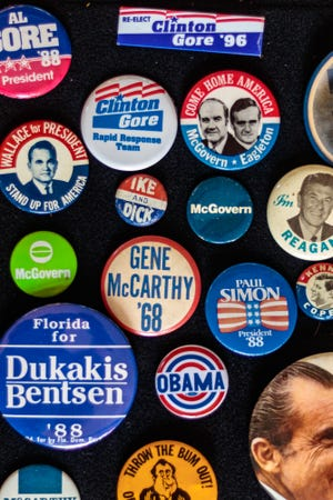 Hardly anyone sports political buttons anymore, but put those away, too. The election's over.