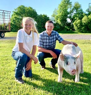 Connor Rodwell and his market hog with Tessa Rodwell, another participant in the Charity Animal Program.