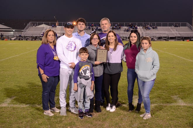 The Gros family gathers during the Ascension Catholic High School football game.