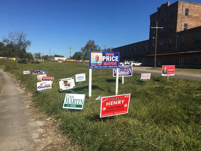 A patch of signs sit near the railroad underpass on East Bayou Road in Donaldsonville.
