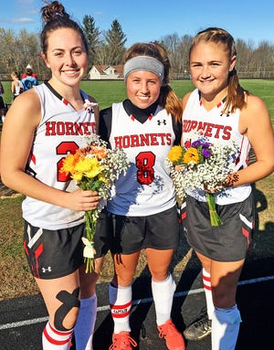 Honesdale's varsity field hockey team defeated Wilkes Barre Area Saturday afternoon to advance to the District Two Class AAA championship game. Pictured here are the Lady Hornet captains who played key roles in this victory (from left): Grace Maxson, Katie Corcoran and Sarah Meyer.