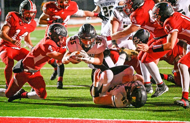 Zane Janiszewski (35) of Western Wayne explodes through the North Pocono defense for a touchdown I Week 5 Lackawanna Football Conference action. The senior tailback rushed for 215 yards in leading the Wildcats to a 27-3 victory over North Pocono.