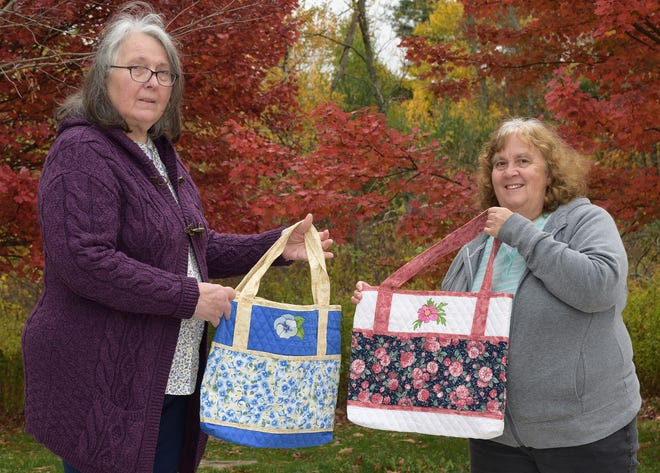 Erie County Council of Garden Clubs President Lynn Jackson, left, and historian Betty Wist display colorful totes that Wist made for the organization's 2020 fundraiser.