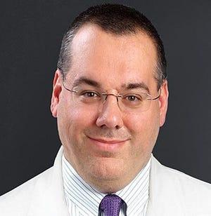Feno Monaco, M.D., is an interventional pain management specialist at SaintVincent Hospital.