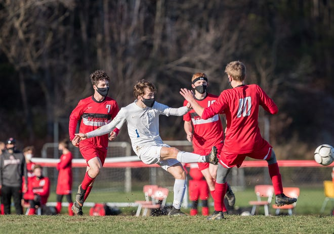 Alfred-Almond's Dylan Coots (1) passes through a crowd of Canisteo-Greenwood defenders, including Pjotr Otten (10) and Anthony Loper (7).