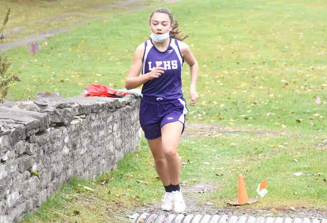 Kaylan Zysk, pictured running an Oct. 24 race on her home course in Little Falls, won the Division II girls' competition at the Center State Conference championship meet Saturday at West Canada Valley.