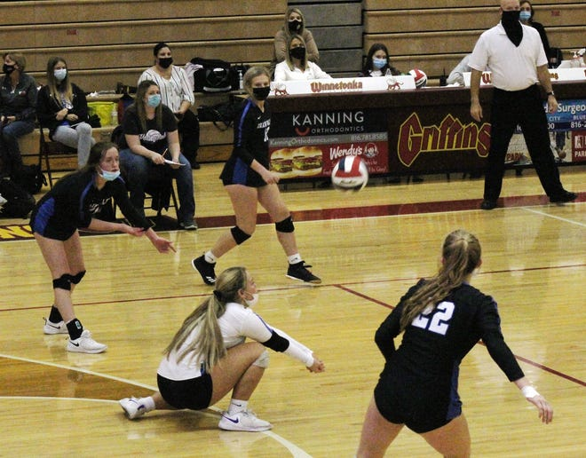 Grain Valley senior libero Clara Gower (in white) digs a Platte County hit in their Class 4 state quarterfinal match Saturday at Winnetonka High School. Grain Valley lost 3-0, just one win away from the state final four.