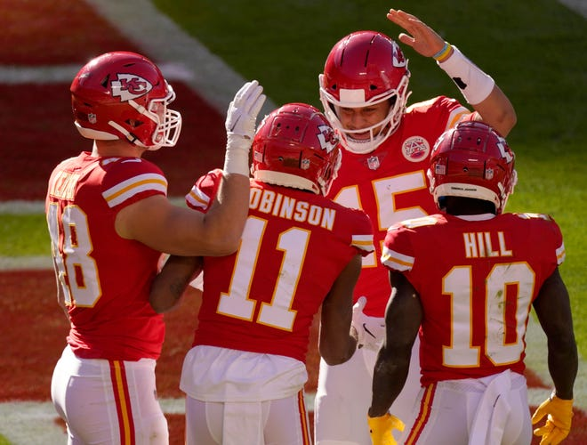 Kansas City Chiefs' Nick Keizer (48), Demarcus Robinson (11), Tyreek Hill (10) and Patrick Mahomes (15) celebrate a touchdown scored on a catch by Robinson in the second half of Sunday's game against the New York Jets at Arrowhead Stadium.