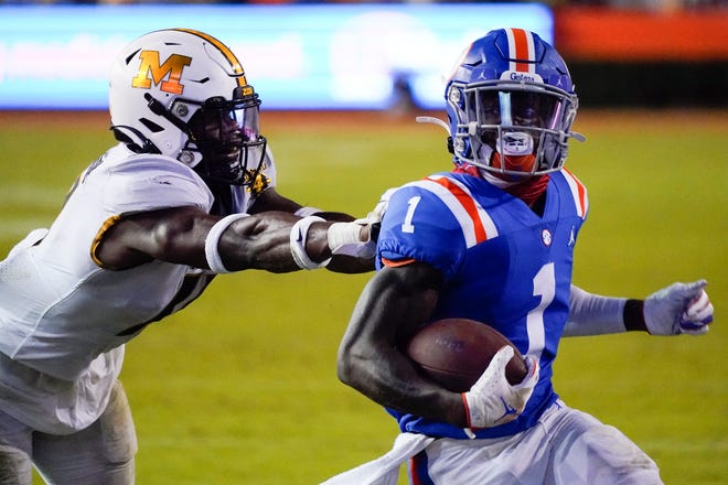 Florida wide receiver Kadarius Toney (1) runs for a 16-yard touchdown as he gets past Missouri linebacker Devin Nicholson during the second half of Saturday's game in Gainesville, Fla. Toney scored three touchdowns in Florida's 41-17 win.