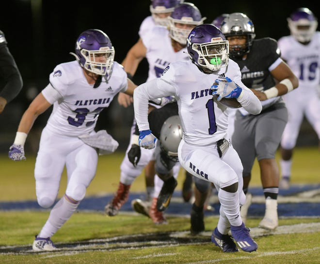 Fletcher High running back Myles Montgomery (1) gets loose for a big gain against First Coast Monday, November 2, 2020 at First Coast High in Jacksonville, Florida. (Will Dickey/Florida Times-Union)