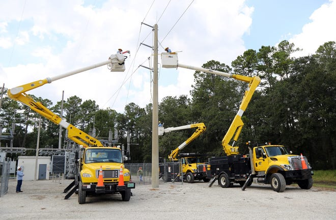 Clay Electric Cooperative crews work at one of its power substations.