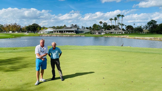 The Yards owner David Miller (left) and general manager Mike Miles stand on one of the greens that will make up part of a six-hole par-3 course, with the clubhouse in the background.