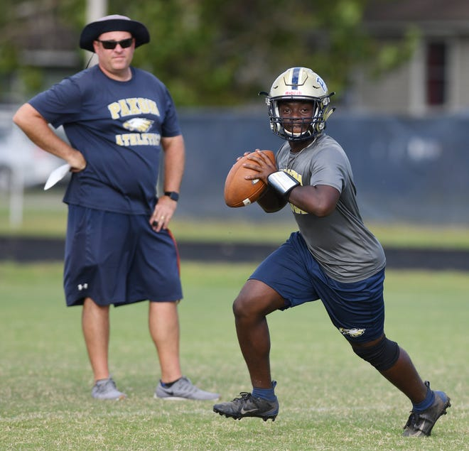 Paxon School for Advanced Studies football coach Steve Brown watches as quarterback Christion Russ (12) runs through drills during his team's practice session on Oct. 29. Paxon, which has never qualified for the FHSAA postseason, meets Tallahassee Godby in a Nov. 13 Class 5A play-in game.