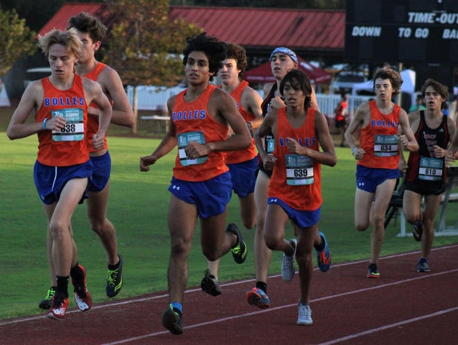 Bolles runners including Aidan Ryan (638), Aidin Hasan (630) and Matthew Thomas (639) run near the head of the field at the FHSAA District 4-2A boys cross country championships.
