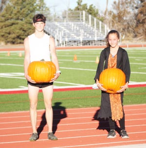 Josh Snyder (left) and Larriana Taggert were the winners of the Rocky Ford Halloween Pumpkin races which took place last Saturday.