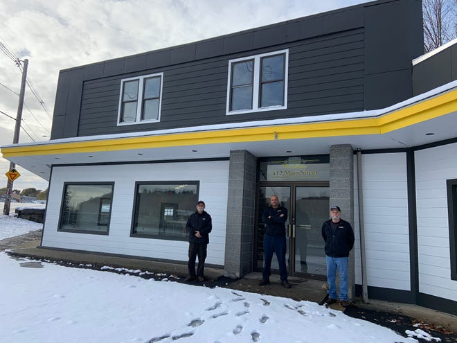 Meineke in Gardner will move to its new location at 412 Main St. at the end of November. From left are Mark Blake, owner Russell Blake and Brian Blake.