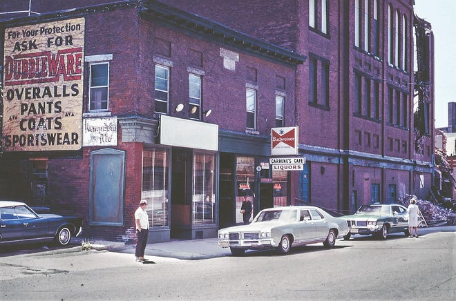 Carbone Cafe in 1973, with the Uptown Theater, far right, in the midst of being torn down.