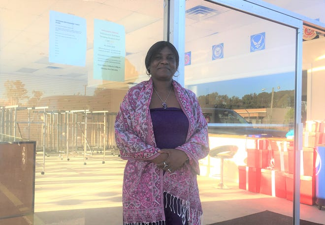 Yvette Davis, the mother of a U.S. Army veteran who died by suicide in 2018, poses for a photo outside of the International Veterans Empowerment Thrift Store in Jacksonville, Oct. 30. Davis plans on using funds raised from the store to help veterans in need find effective mental health care.