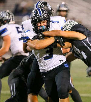 CVCA running back Kyle Snider hangs onto the ball during the Royals playoff loss to Lake Catholic Oct. 24. CVCA rebounded with a 28-21 win at Salem Oct. 30.