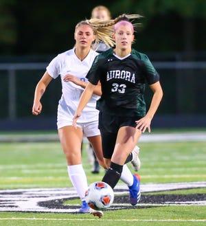 Aurora's Carlie Filkouski brings the ball ahead during a game earlier this season.