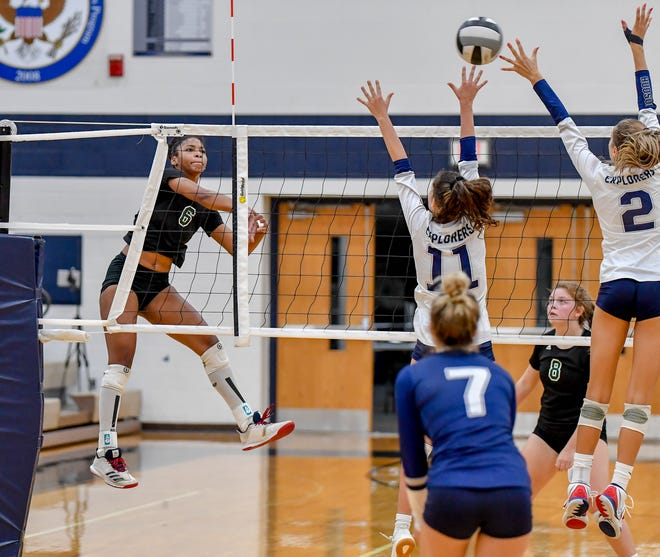 Nordonia outside hitter Joy Banks puts down a cross-court kill during a game earlier this season. Banks and the Knights won Nordonia's first district title in decades Oct. 31 with a three-set win over Austintown-Fitch. [Photo courtesy of K.M. Klemencic]