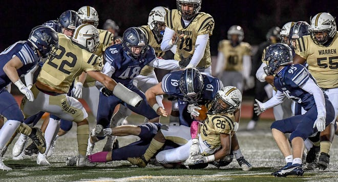 Hudson's Chase Webber (19) makes a tackle during the Explorers' 35-6 win over Warren G. Harding Oct. 31.
