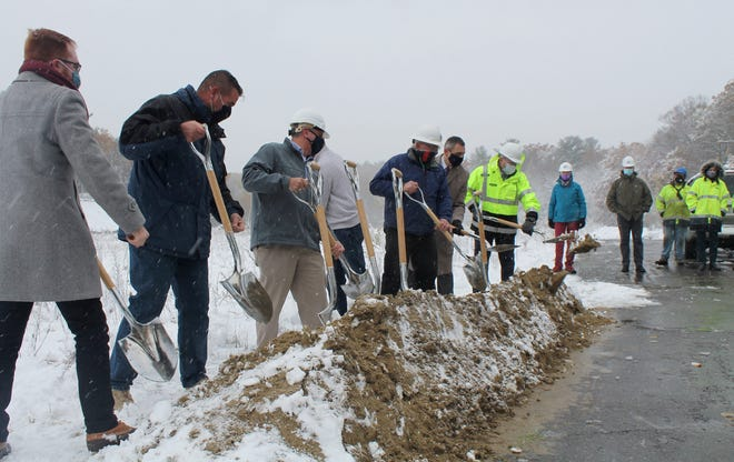 Holden town officials, including selectmen, joined to do the ceremonial groundbreaking Oct. 30 at the site of the new DPW facility on Industrial Drive as a welcoming snow coated the area.