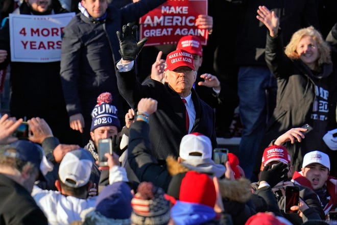 President Donald Trump works the crowd as he departs after addressing a campaign rally at the Wilkes-Barre Scranton International Airport in Avoca, Pa, on Monday.