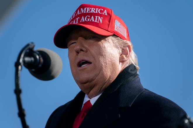 President Donald Trump speaks during a campaign rally at Fayetteville Regional Airport on Monday in Fayetteville, N.C.