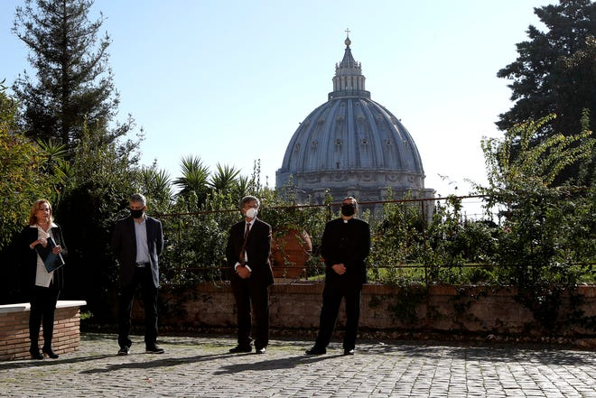 "Rosetta Sannelli, director of the Kineo Movie for Humanity Award, from left, director Evgeny Afineevsky, Paolo Ruffini, prefect of the dicastery of Communication, and Monsignor Ruiz, secretary of the dicastery, pose for a photo during the award ceremony at the Vatican on Oct. 22. Director Evgeny Afineevsky was awarded with Kineo prize for the movie ""Francesco."""