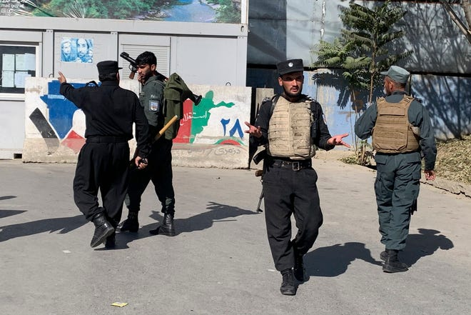 Afghan police arrive at the site of an attack at Kabul University in Kabul, Afghanistan, on Monday.