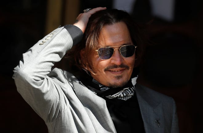 "Actor Johnny Depp arrives at the High Court in London during his case against News Group Newspapers over a story published about his former wife Amber Heard, which branded him a ""wife beater."""