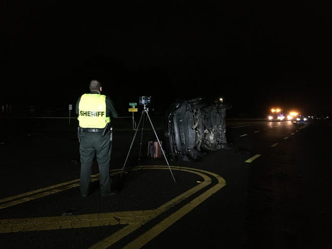 Polk County Sheriff's Office investigators work the scene of a fatal crash on State Road 33 in Polk City on Sunday night.