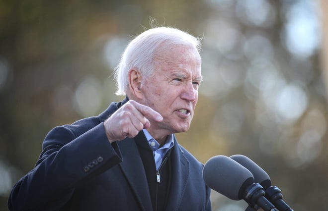 Democratic presidential candidate Joe Biden speaks to supporters at the Iowa State Fairgrounds in Des Moines on Friday.