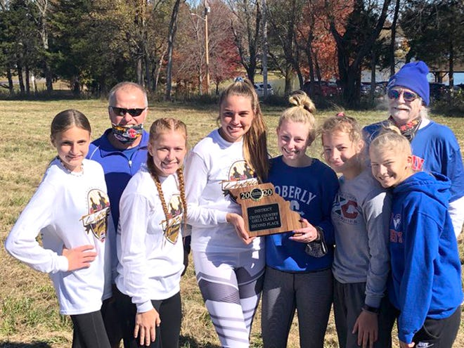 Moberly varsity girls cross country team placed second at the 2020 MSHSAA Class 4 District 4 meet to qualify for the state championships being held Nov. 6 in Columbia. Team members are Melana Pence, AriAnna Wilkey, Isabella Ross, Maggie Crist, Chloe Ross and Anna Rivera. Standing behind the runners are assistant coach Brian Hunsaker and head coach Greg Carroll (right).