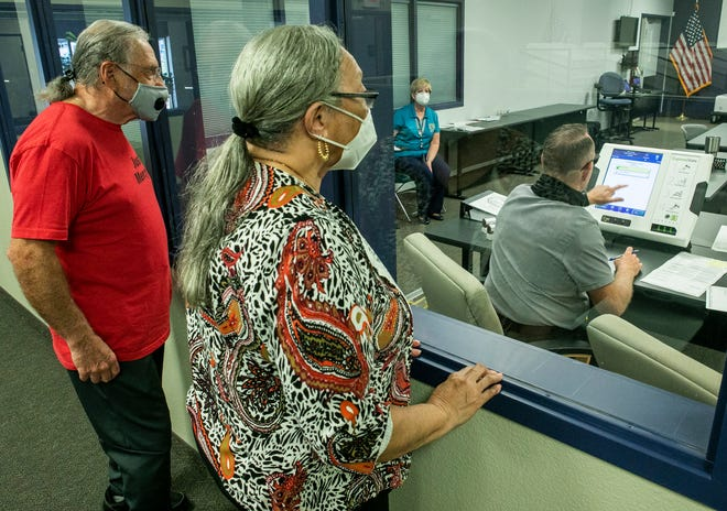 Don Mossa, left, and Joyce Blake, both Democrats, watch as Marion County Commissioner Jeff Gold duplicates a ballot after the machine kicked it back. Gold is part of the canvassing board that oversees the election process and validates votes in question. Election workers were separating ballots from envelopes and others ran them through machines to be counted on Monday afternoon.