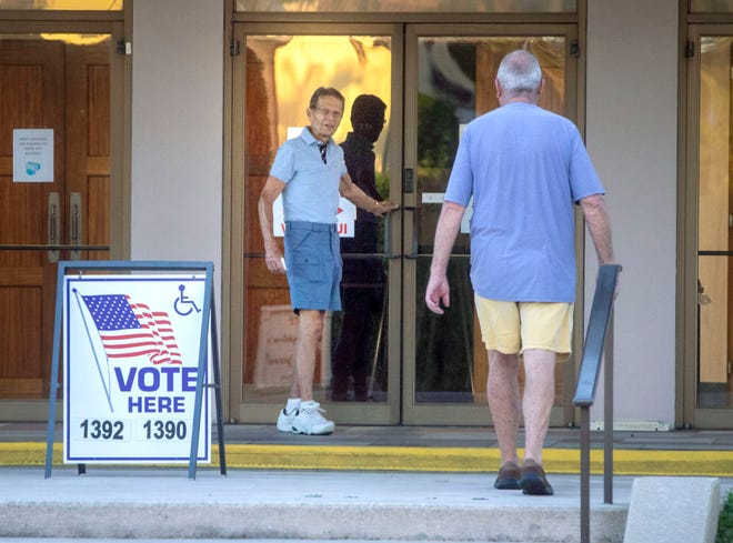 A small number of people, mostly seniors, trickled into the St. Edward Parish Center to cast their votes for the August primary when the polling stations opened in Palm Beach. [DAMON HIGGINS/palmbeachpost.com]