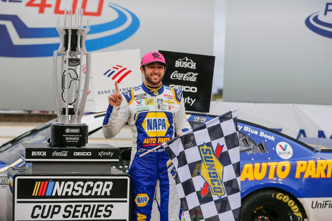 Chase Elliott stands by his trophy in victory lane after winning a NASCAR Cup Series auto race at Charlotte Motor Speedway in Concord, N.C., Sunday, Oct. 11, 2020.  Elliott will contend for his first championship at Phoenix Raceway on Sunday, Nov. 8, 2020. (AP Photo/Nell Redmond, File)