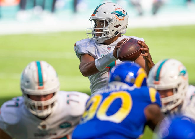 Dolphins quarterback Tua Tagovailoa takes a snap against Los Angeles Rams.