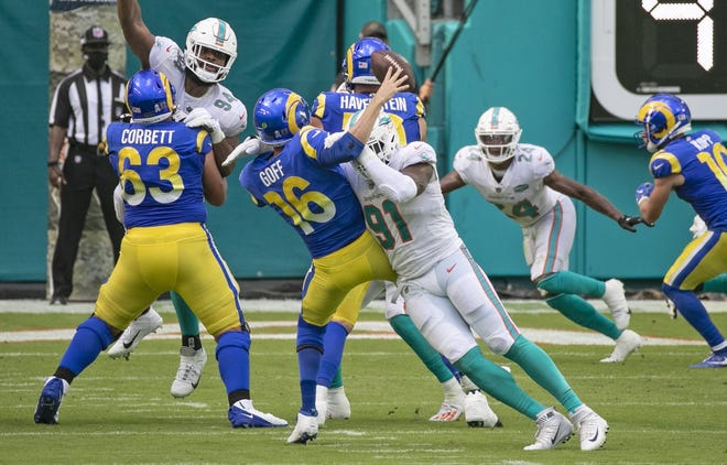 Miami Dolphins defensive end Emmanuel Ogbah (91) causes Los Angeles Rams quarterback Jared Goff (16) to fumble the ball in the second quarter on Sunday, Nov. 1, 2020 at Hard Rock Stadium in Miami Gardens, Florida. (Charles Trainor Jr./Miami Herald/TNS)