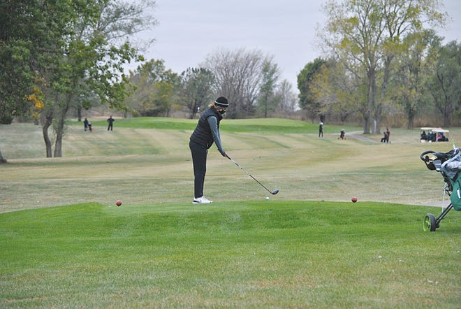 Pratt High School freshman Avery Blasi tees off at Emporia for the first round of the State girls golf tournament. She placed 12th overall.