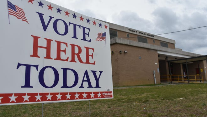 A sign outside Blandford Academy in Petersburg, Va. reminds voters in the city's Ward 1 where they can cast ballots in this undated file photo.